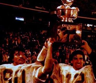 Oliver Luck - Darryl Talley (left) and Oliver Luck celebrate WVU's 1981 Peach Bowl victory