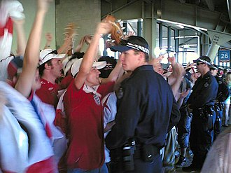 Barmy Army - The Barmy Army and police at the Gabba, November 2006.