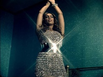 "Bleeding Love - Lewis wearing a Dolce & Gabbana crystal gown in the music video for ""Bleeding Love"""