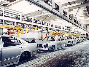 Conveyor system - An overhead chain conveyor conveys cars at Mercedes in Germany