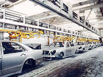 Conveyor system - An overhead chain conveyor conveys cars at Mercedes in Germany