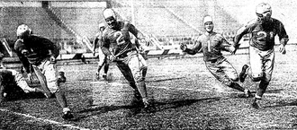 "Ernie Caddel - Caddel (No. 1) in January 1936 with newspaper caption, ""Here's How Stellar Lion Halfback Makes those Long Gains"""