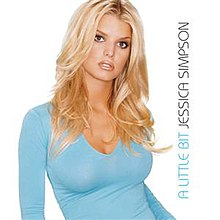 "A blond woman looks to the front. She wears an indigo colored top, and is standing in front of a white background. To the right of the picture, the words ""A Little Bit"" and ""Jessica Simpson"" are written upside down vertical."