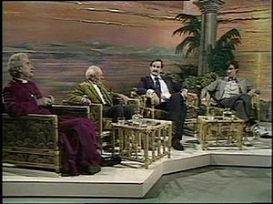 "Friday Night, Saturday Morning - (from left to right) Mervyn Stockwood (The Bishop of Southwark), Malcolm Muggeridge, John Cleese and Michael Palin on Friday Night, Saturday Morning. Stockwood is telling Cleese and Palin ""you'll get your thirty pieces of silver""."