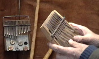Andrew Tracey - The mbira (left) and the karimba or mbira nyunga nyunga in Andrew Tracey's hands.