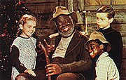 From left to right: Ginny (Luana Patten), Uncle Remus (James Baskett), Johnny (Bobby Driscoll) and Toby (Glenn Leedy).
