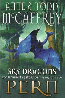 Book dust jacket showing a blue dragon, with its much smaller rider straddling the base of its neck, flying past the trunks of two large trees