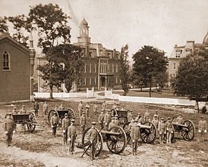 West Virginia University - WVU's Cadet Corps, c. 1880. Taken from the site of where Oglebay Hall is now located, Martin Hall (center) and Woodburn Hall (right) in background.
