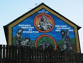 """""""Ireland's Holocaust"""" mural in The Falls, Belfast. """"An Gorta Mór, Britain's genocide by starvation, Ireland's holocaust 1845-1849."""""""