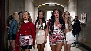 "Black Magic (song) - Little Mix as seen walking down the hallway of the campus in the music video for ""Black Magic""; this scene was inspired from the 1996 cult film The Craft."