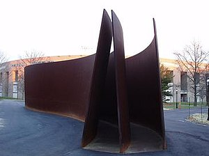 Princeton University Art Museum - Richard Serra, The Hedgehog and the Fox, 1999, with the Princeton University Stadium in the background