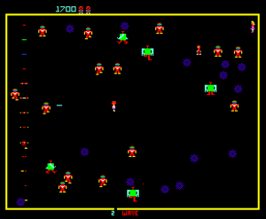 Robotron: 2084 - The protagonist (center) shoots the robots while dodging their attacks and attempting to rescue the human (top right).
