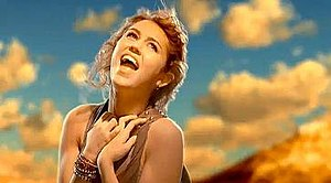 "The Climb (Miley Cyrus song) - Cyrus portrayed singing at the top of the mountain in the music video to ""The Climb"". This setting is similar to that of the music video for ""I'm Not a Girl, Not Yet a Woman"" by Britney Spears."