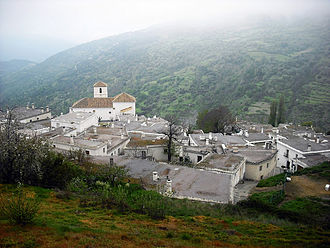 """Rebellion of the Alpujarras (1499–1501) - An Alpujarran village in 2012, retaining many features from the time of Muslim inhabitants - narrow streets, flat roofs, """"bowler-hat"""" chimneys. The uprisings took place in such villages."""