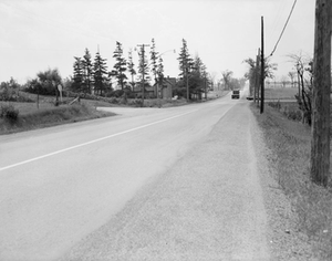Ontario Highway 404 - Facing south along Woodbine Avenue in 1965; the crossroad is Finch Avenue, which passes over the ten lane freeway that has since replaced this rural road