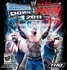 "On the left, a large bald wrestler in a wrestling singlet clenches his fist, in the middle another wrestler wearing jeans holds his arms up, on the right, a blonde man holding a wrestling title belt screams into a microphone. Above them is a logo that reads ""WWE Smackdown vs. Raw 2011. In the lower left is a logo that reads ""RP"" and in the bottom right is a logo that reads ""THQ""."