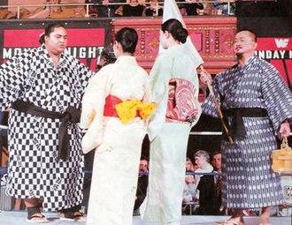 Yokozuna (wrestler) - Yokozuna (left) and Mr. Fuji on the very first episode of Monday Night Raw