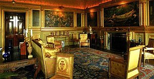 The Legend of Briar Rose - View of the Saloon at Buscot Park showing two of the major panels – The Garden Court and The Rose Bower – in their context between the adjoining panels