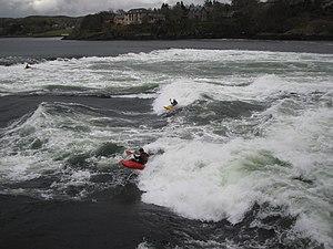 Falls of Lora - Kayakers playboating on Falls of Lora