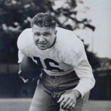 Terlep carrying a football in a white uniform