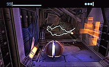 A metallic ball stands in a futuristic corridor, with sparks of electricity in the background. Atop the image is a bar and a number indicating the health of the player, and three round icons indicating the remaining bombs.