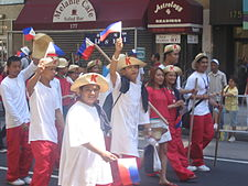 Photograph of young male and femal Filipinos dressed as Katipuneros in Midtown Manhattan.