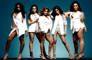 Boss (Fifth Harmony song) - The members of Fifth Harmony stand united wearing white-colored outfits, displaying confidence and self-empowerment.