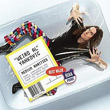 "The cover to Medium Rarities, depicting ""Weird Al"" Yankovic shrink-wrapped in meat packaging"