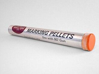 Paintball equipment - Original Nelson paint tube produced around 1985 for oil-based paintballs.
