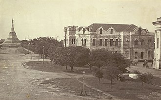 History of Myanmar - Recorder's Court on Sule Pagoda Road, with the Sule Pagoda at the far end, Rangoon, 1868. Photographer: J. Jackson.