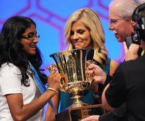 Scripps National Spelling Bee - Snigdha Nandipati (left), 2012 Scripps National Spelling Bee champion, receives her trophy.