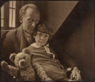 A. A. Milne - Milne with his son Christopher Robin and Pooh Bear, at Cotchford Farm, their home in Sussex. Photo by Howard Coster, 1926.