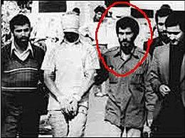 Iranian militants escort a blindfolded U.S. hostage to the media.