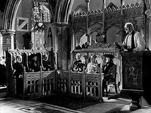 Kind Hearts and Coronets - Scene showing Alec Guinness in six of the roles he portrayed (second from the left is Valerie Hobson as the recently widowed Edith). The cinematographer Douglas Slocombe masked the lens and filmed over several days to achieve the shot.