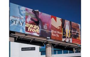Jonathan Barnbrook - Designers, stay away from corporations that want you to lie for them; on billboard, Las Vegas. (c) Jonathan Barnbrook, 1999