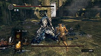 Dark Souls - The player character (right) battling Knight Artorias, one of the bosses added to the game through downloadable content