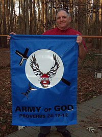 Donald Spitz holds Army of God Banner.jpg