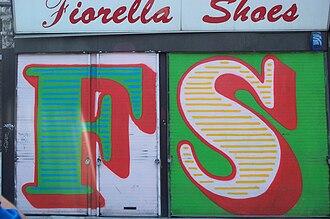 Ben Eine - Eine's shutter lettering on Hackney Road, London