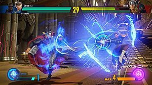 Marvel vs. Capcom: Infinite - A gameplay screenshot of Thor battling Chun-Li, illustrating the change to two-on-two battles and the inclusion of the Infinity Stones.