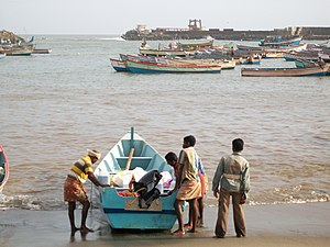 Vizhinjam - Fishermen about to set sail for the day from Vizhinjam Harbour. The wave energy demonstration plant can be seen in the background.
