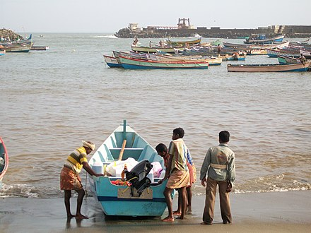 Vizhinjam Wave Power Plant in the backdrop VIZHINJAM FISHING HARBOUR.jpg