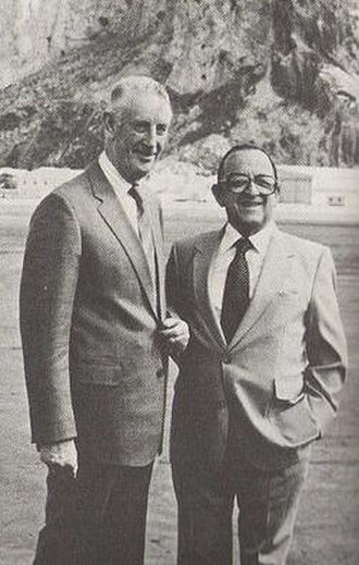 William Jackson (British Army officer) - Sir William Jackson (left) with Sir Joshua Hassan, Chief Minister of Gibraltar (right), awaiting the arrival in Gibraltar of Charles, Prince of Wales in 1977.
