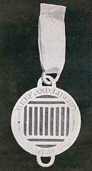 "Beefsteak Club - Badge of the Sublime Society: a gridiron and the motto ""Beef and Liberty"""
