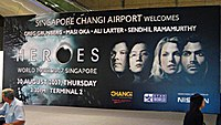 Billboard for Heroes World Tour, Singapore Changi Airport, Singapore.