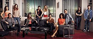 Hollywood Heights (TV series) - Pictured: (standing, l-–r) Melissa (Ashley Holliday), Nora (Jama Williamson), Eddie (Cody Longo, on ledge), Chloe (Melissa Ordway), Kelly (Yara Martinez), Adam (Nick Krause) (sitting, l-r) Max (Carlos Ponce), Loren (Brittany Underwood), Tyler (Justin Wilczyniski), Traci (Shannon Kane), Jake Brandon Bell