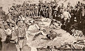 Italian Alpini and Libyan corpses
