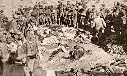 "Italian Alpini and Libyan corpses after the attack against ""Ridotta Lombardia"". Italians in Libya.jpg"