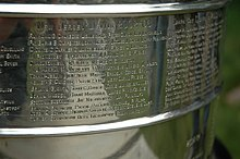 Jamie Langenbrunner's name is pictured in a close-up photograph of the extremely shiny Stanley Cup trophy.