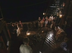 Pirate Master - Pirates' Court is held; Daddo (in front) addresses those with the Black Spot (left), the Captain and his Officers (upper right), and the remaining crew (right), with the Chest of Zanzibar in the front right.