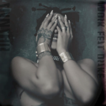 Rihanna covering her face with her hands